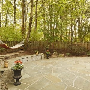 Large stone patio on beautiful property.